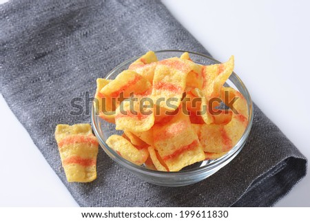puffed crisps with the flavor of bacon - stock photo