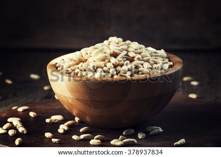 Puffed rice in a wooden bowl, selective focus - stock photo