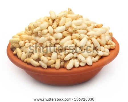 Puffed rice on a clay pot