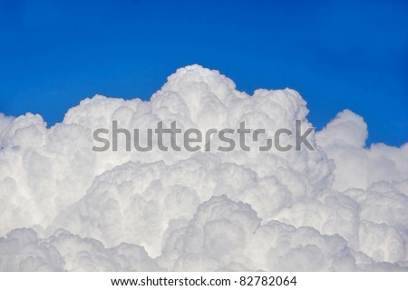 Puffy clouds and blue sky - stock photo