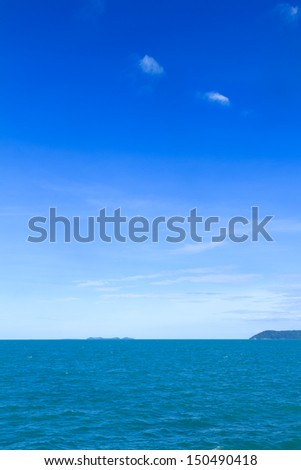 Puffy white cloud and blue sky background - stock photo
