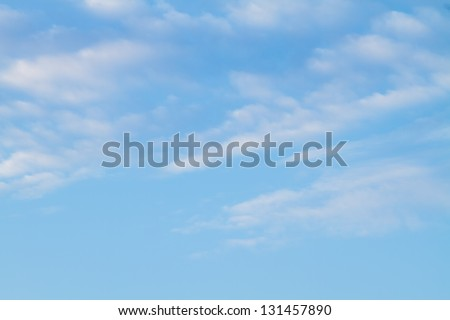 Puffy white clouds against a perfect blue sky. - stock photo