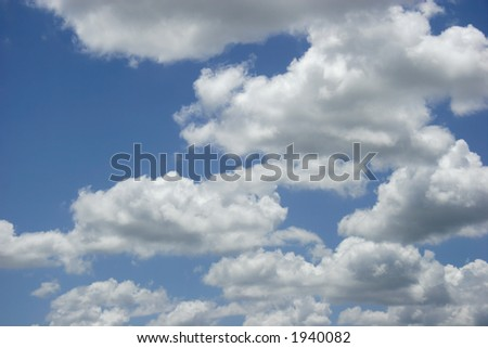Puffy White Clouds, Blue Sky - stock photo