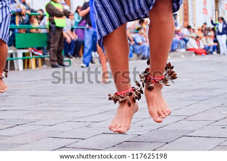 PUJILI, ECUADOR - 25 JUNE :feet of indigenous man dancing in traditional costume, Inti Raymi festivities, 25 June 2011 PUJILI, ECUADOR - stock photo
