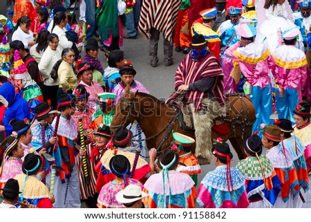 PUJILI, ECUADOR - 25 JUNE : GROUP OF MEN DRESSED IN TRADITIONAL COLORFUL COSTUMES ON THE STREETS OF PUJILI, INTI RAYMI FESTIVAL CELEBRATED ON 25 JUNE 2011