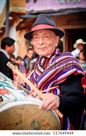 PUJILI, ECUADOR - 25 JUNE : indigenous elder in traditional costume, Inti Raymi festivities, 25 June 2011 PUJILI, ECUADOR - stock photo