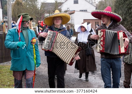 PUKLICE, CZECH REPUBLIC - JANUARY 13, 2016: People attend the Masopust Carnival, a traditional ceremonial door-to-door procession in small village. January 13, 2016 in Puklice, Czech Republic