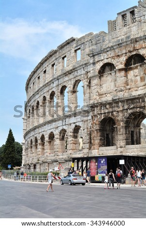 PULA, CROATIA - JULY 13, 2015: tourists at the Arena in Pula, the landmark of the city