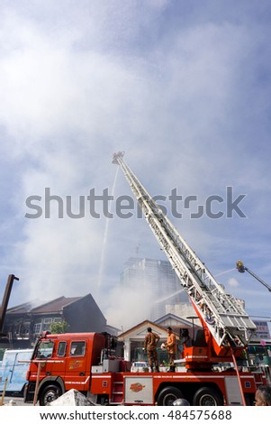 Pulau Pinang,Malaysia 6 SEPT 2016:Firefighters in action, Fireman on an extended boom fighting a fire with a water hose