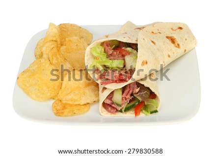 pulled pork and salad bread wraps with crisps on a plate isolated against white