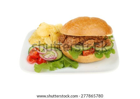 Pulled pork bread roll with salad and potato crisps on a plate isolated against white - stock photo