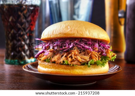 Pulled pork burger with red cabbage salad - stock photo