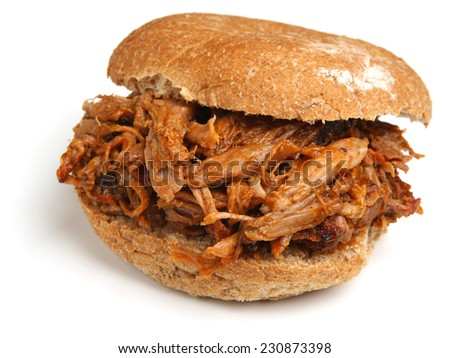 Pulled pork or hog roast sandwich with bbq sauce. - stock photo