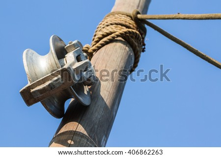 Pulley and old rope on bamboo pole