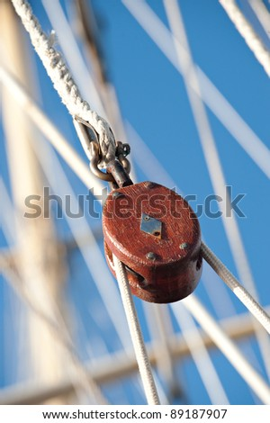Pulley block.  Detail of a passenger cruise ship sailing in the Society Islands, Tahiti. - stock photo