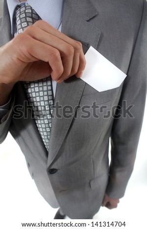 Pulling card out of pocket - stock photo
