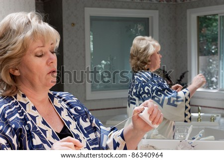 Pulling out some dental floss - stock photo