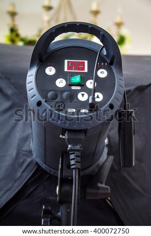 Pulse studio flash on a stand, back view, with buttons and indicators