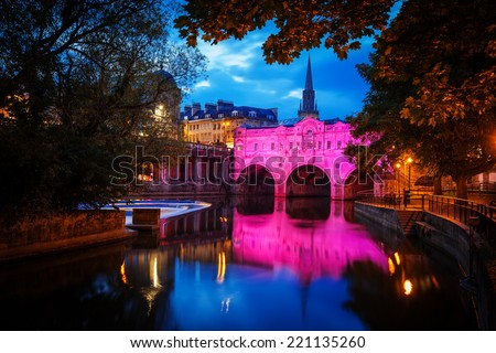 Pulteney Bridge in Bath at night with colourful lighting - stock photo