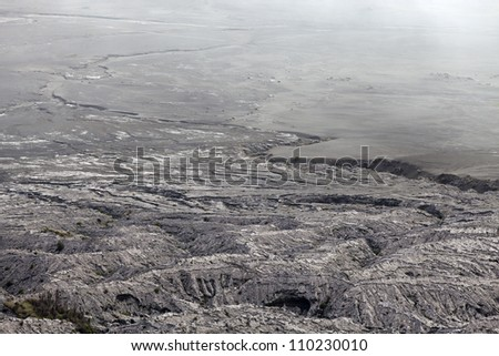 pumice after volcano eruption, gray background - stock photo