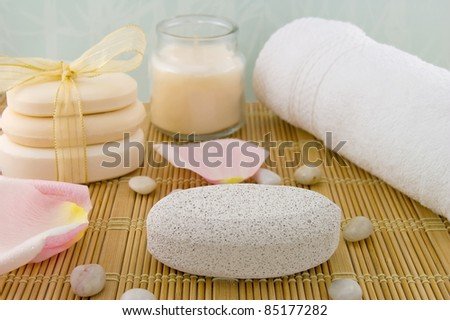 Pumice stone, white bath towel, bars of soap, scented candle./Clean Feet - stock photo