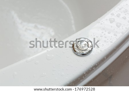 Pump button of Jacuzzi in bathroom - stock photo