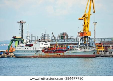 Pump-dredge ship under port crane bridge, Odessa, Ukraine - stock photo