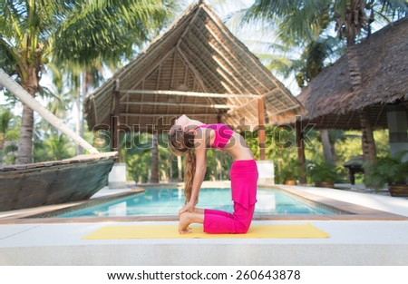 pumping buttocks. photo of the girl involved in fitness at the pool - stock photo