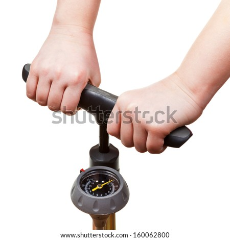 pumping by manual air pump with pressure indicator isolated on white background