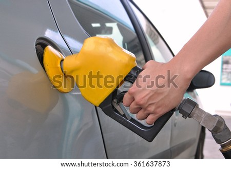 Pumping gasoline from a fuel pump using a yellow nozzle