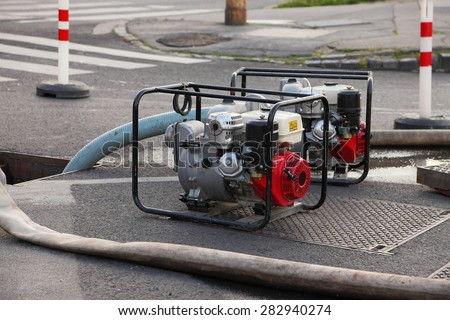 Pumping out water from a flooded area - stock photo