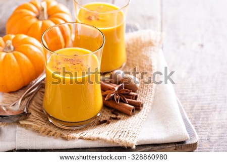 Pumpkin and orange spiced fall drink with cinnamon - stock photo