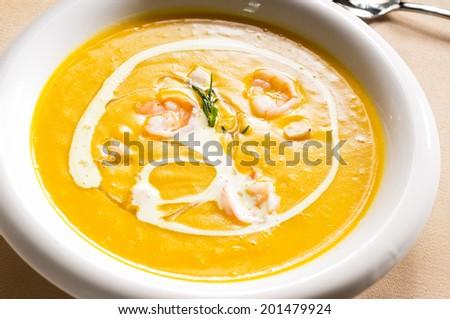 pumpkin and shrimps cream soup - stock photo