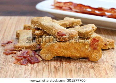 Pumpkin, bacon dog biscuits on a cutting board.  A homemade and healthy treat for your dog. - stock photo