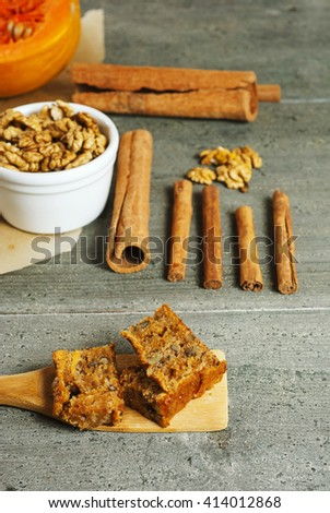 pumpkin cake and ingredients, aged wood table background