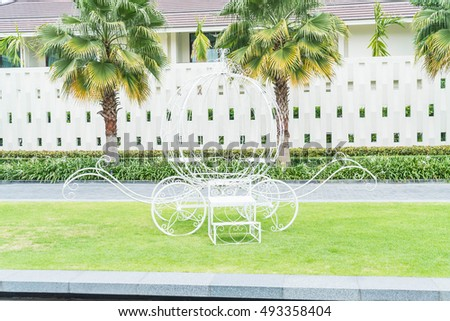 pumpkin carriage decoration in the garden with empty space