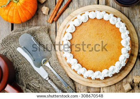 pumpkin cheesecake decorated with whipped cream. the toning. selective focus - stock photo