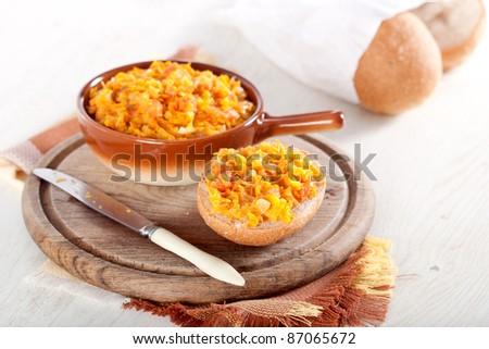 Pumpkin chutney and fresh bread - stock photo