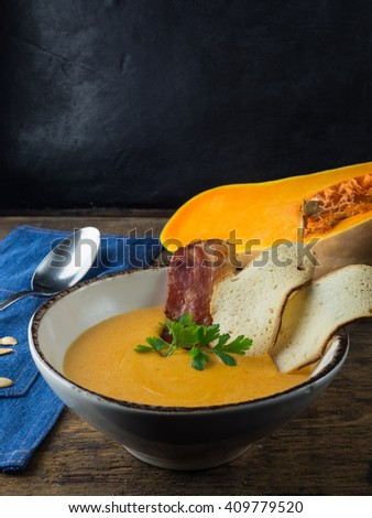 pumpkin cream soup. - stock photo