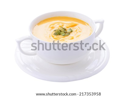 Pumpkin cream soup in bowl on white background - stock photo