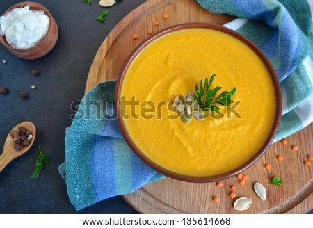 Pumpkin cream soup, with lentils and cream cheese  - stock photo