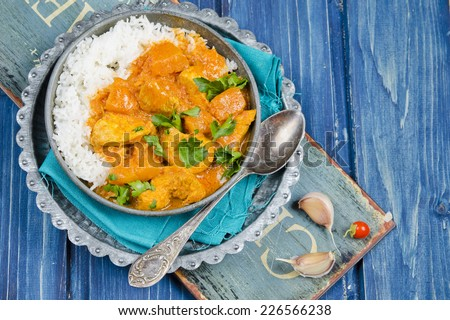 Pumpkin curry with chicken. - stock photo