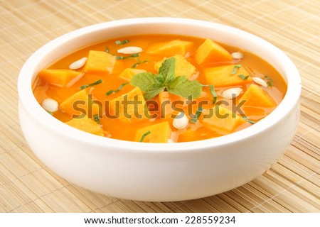 Pumpkin curry with spices. - stock photo