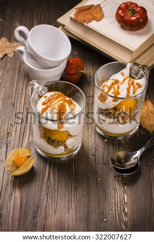Pumpkin dessert in glass cups. Layered pumpkin tiramissu. Vintage style. Selective focus
