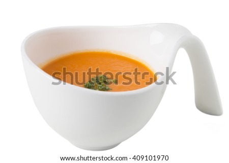 Pumpkin detox soup with herbs. Isolated on a white background. - stock photo