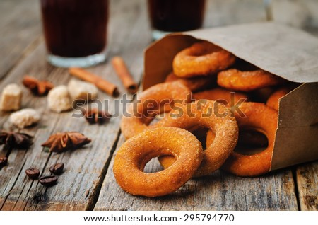 pumpkin donuts on a dark wood background. the toning. selective focus - stock photo