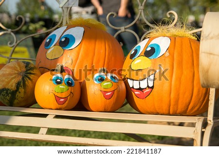 pumpkin family on bench