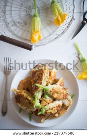 pumpkin flowers stuffed with ricotta - stock photo
