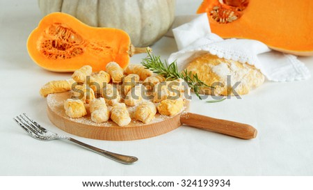 pumpkin gnocchi uncooked on the wooden board - stock photo