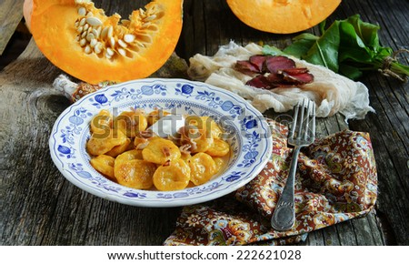 pumpkin gnocchi with greaves - stock photo